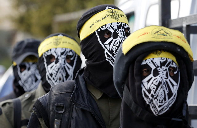 Masked members of the al-Aqsa Martyrs' Brigades, a coalition of Palestinian armed groups in the West Bank, march during the funeral of Ali Thawabteh and Ali Taqatqa in the West Bank village of Beit Fajjar, south of Bethlehem March 20, 2016. (Photo by Abed Al Hashlamoun/EPA)