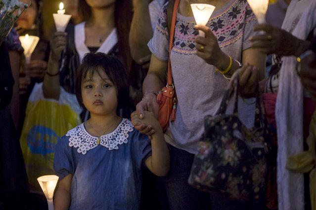 A girl from the Nepalese community holds a candle during a candlelight vigil in remembrance of the victims of the earthquake that devastated parts of Nepal a week ago, in Hong Kong, China May 2, 2015. (Photo by Tyrone Siu/Reuters)
