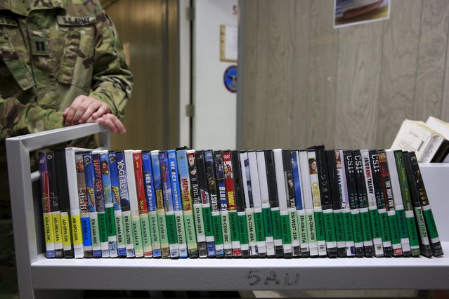A soldier shows entertainment options that are available to detainees in Joint Task Force Guantanamo's library at the U.S. Naval Base in Guantanamo Bay, Cuba March 22, 2016. (Photo by Lucas Jackson/Reuters)