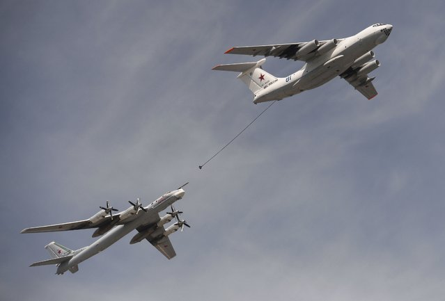 An Ilyushin Il-78 Midas air force tanker and a Tupolev Tu-95MS strategic bomber fly over the Red Square during the Victory Day parade in Moscow, Russia, May 9, 2015. (Photo by Reuters/Host Photo Agency/RIA Novosti)