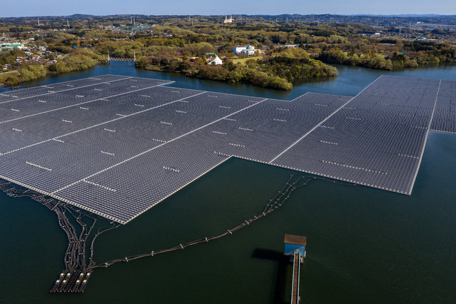 A general view of the Yamakura Dam floating solar plant on April 16, 2019 in Ichihara, Japan. Activated in March 2018 and the largest power plant of its type in Japan, the solar plant was constructed on the surface of Yamakura Dam reservoir and covers over 44 acres of surface area with 50,904 solar modules generating approximately 16,170 megawatt hours (MWh) per year – enough electricity to power approximately 4,970 typical households. (Photo by Carl Court/Getty Images)