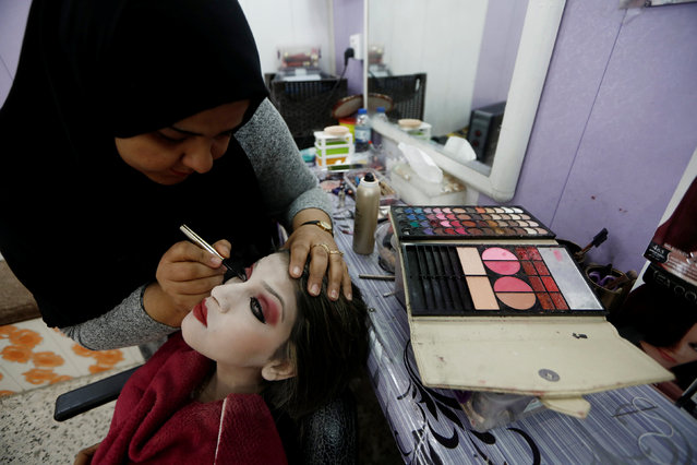 Chahad, 16, gets groomed at a beauty Salon in Kalak before her wedding party, Iraq February 16, 2017. (Photo by Zohra Bensemra/Reuters)