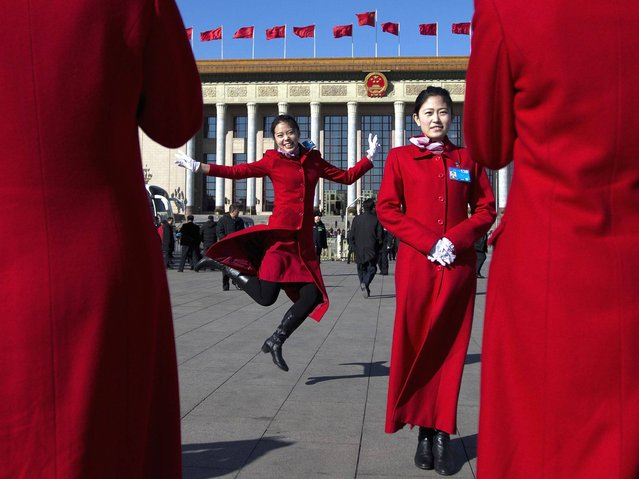 Chinese hostesses, who serve the delegates of the Chinese People's Political Consultative Conference and National People's Congress, have souvenir photos taken in front of the Great Hall of the People during sessions of the CPPCC and NPC held in Beijing, China Tuesday, March 4, 2014. (Photo by Andy Wong/AP Photo)