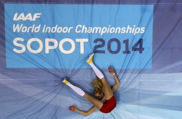 Poland's Justyna Kasprzycka competes in the women's high jump qualification during the world indoor athletics championships at the ERGO Arena in Sopot March 7, 2014. (Photo by Kai Pfaffenbach/Reuters)