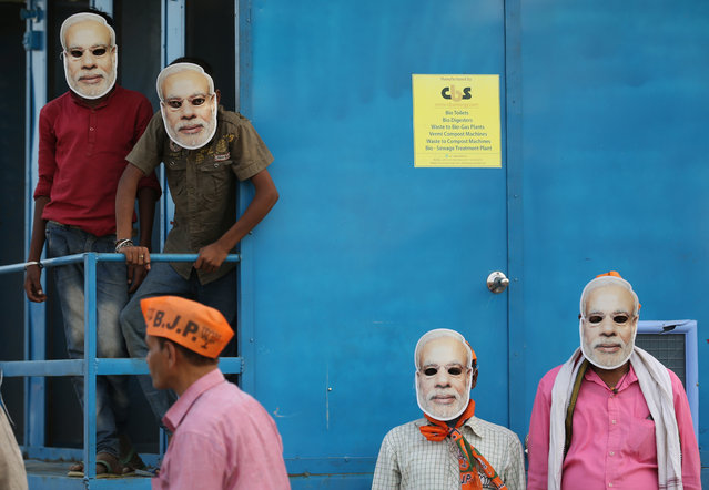 In this May 9, 2019, photo, India's ruling Bharatiya Janata Party (BJP) supporters wear masks of Indian prime minister Narendra Modi and wait for his arrival during an election campaign rally in Prayagraj, India. India's multi-phase elections, which started April 11 and last five weeks, are seen as a referendum on Prime Minister Narendra Modi and his Hindu nationalist BJP. (Photo by Rajesh Kumar Singh/AP Photo)