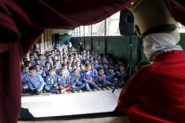 Kids react as they watch a theater puppet show at an UNRWA school in Burj al-Barajneh in Beirut May 14, 2015. (Photo by Mohamed Azakir/Reuters)