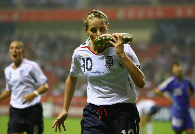 Kelly Smith of England celebrates scoring the first goal for England during the FIFA Women's World Cup 2007 Group A match between Japan and England at the Shanghai Hongkou Football Stadium on September 11, 2007 in Shanghai, China. (Photo by Paul Gilham/Getty Images)