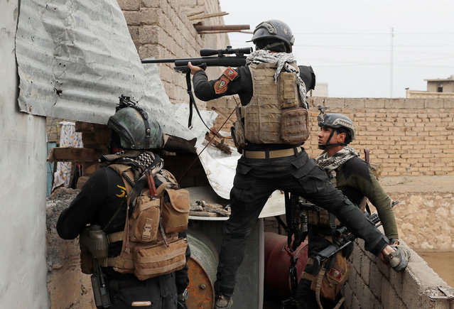 An Iraqi special forces soldier fires a sniper rifle during a battle with Islamic State militants in Mosul, Iraq March 2, 2017. (Photo by Goran Tomasevic/Reuters)
