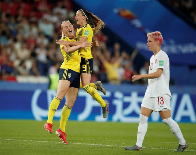 Sweden's Stina Blackstenius celebrates with Kosovare Asllani, right, after scoring the opening goal during the Women's World Cup round of 16 soccer match between Sweden and Canada at the Parc des Princes in Paris, France, Monday, June 24, 2019. (Photo by Benoit Tessier/Reuters)