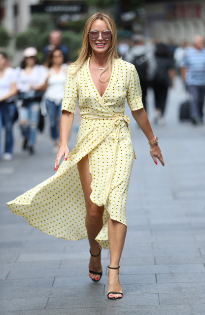 Amanda Holden, 48, laughs off a gust which blew apart her polka dot dress on July 8, 2019 in London, England. (Photo by Splash News and Pictures)