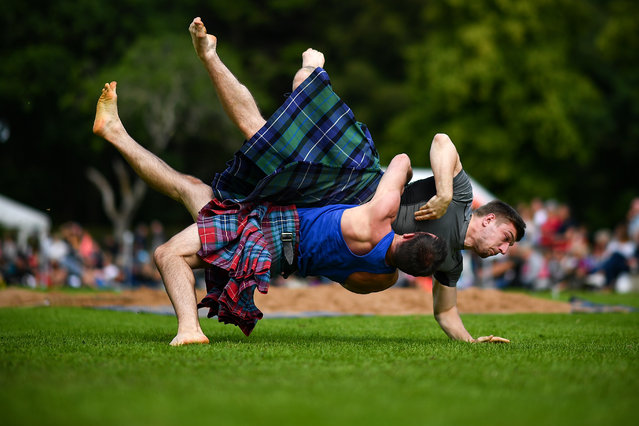 Wrestlers compete at Inveraray Highland Games on July 16, 2019 in Inverarary, Scotland. (Photo by Jeff J. Mitchell/Getty Images)