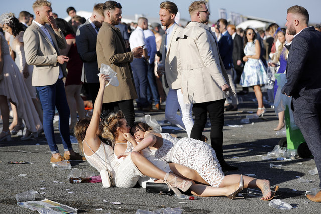 Racegoers during the Grand National Festival at Aintree Racecourse on April 7, 2017 in Liverpool, England. (Photo by Darren Staples/Reuters/Livepic)