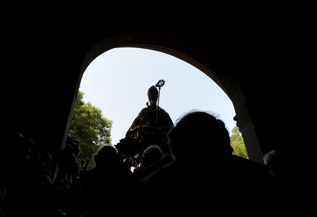 The statue of San Fermin is carried under an arch during a procession in honour of the saint at the San Fermin Festival in Pamplona, northern Spain, July 7, 2015. (Photo by Eloy Alonso/Reuters)