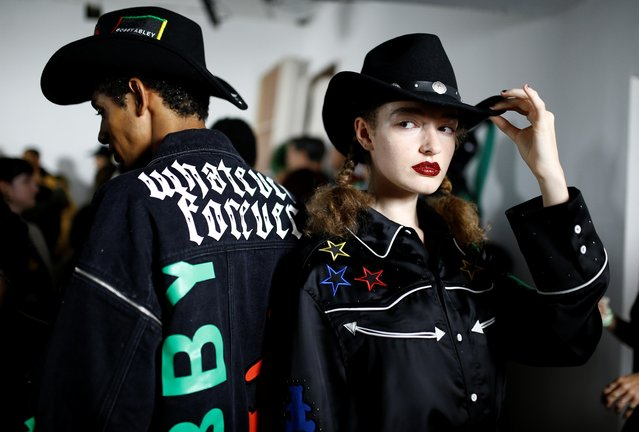 Models prepare backstage ahead of the Bobby Abley catwalk show at London Fashion Week in London, Britain, September 17, 2019. (Photo by Henry Nicholls/Reuters)