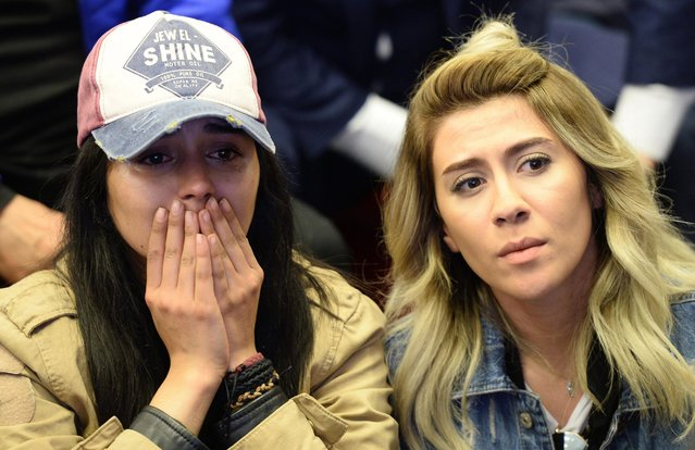 """A supporter of Republican People's Party (CHP) cries as she watches the polling results during a referendum in Ankara, April 16, 2017. Turkey. Millions of Turks are heading to the polls to vote on a set of 18 proposed amendments to the Constitution of Turkey. A """"Yes"""" vote would grant President Recep Tayyip Erdogan, who seeking to replace Turkey's parliamentary system, with full executive powers. (Photo by Erhan Ortac/Getty Images)"""