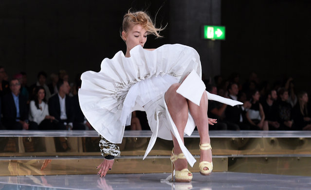 A model slips on the runway while parading an outfit by Australian designer Toni Maticevski at Fashion Week Australia in Sydney on May 15, 2016. (Photo by William West/AFP Photo)