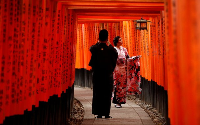 A woman in yukata, casual summer kimono, poses for a photo at Fushimi Inari Taisha in Kyoto, Japan on October 2, 2019. (Photo by Matthew Childs/Reuters)