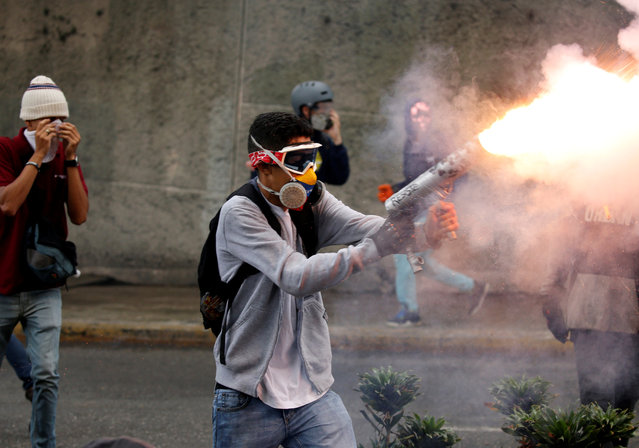 Demonstrator fires a homemade mortar during rally against Venezuela's President Nicolas Maduro in Caracas, Venezuela on May 3, 2017. (Photo by Carlos Garcia Rawlins/Reuters)