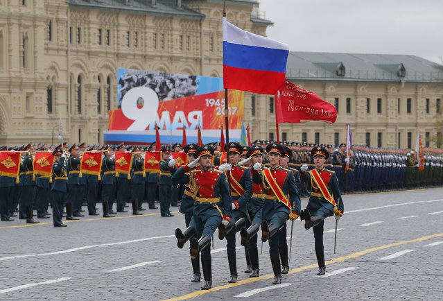 Russian army soldiers march along the Red Square during the Victory Day military parade to celebrate 72 years since the end of WWII and the defeat of Nazi Germany, in Moscow, Russia, on Tuesday, May 9, 2017. (Photo by Yuri Kochetkov/Pool Photo via AP Photo)