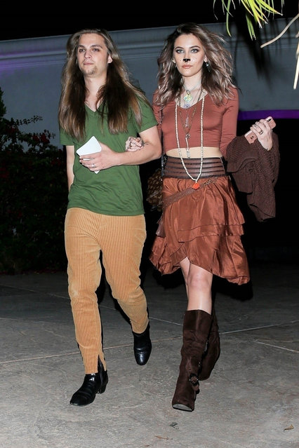 Paris Jackson and boyfriend Gabriel Glenn dress as Shaggy and Scooby-Doo at Paris Hilton's Halloween Party in Beverly Hills, CA. on October 24, 2019. The couple were in good spirits as they held hands while exiting the party. (Photo by Backgrid USA)