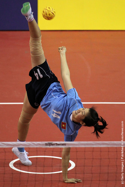 Sepaktakraw: Nguyen Thi Bich Thuy of Vietnam serves to Japan during day one of the ISTAF Super Series
