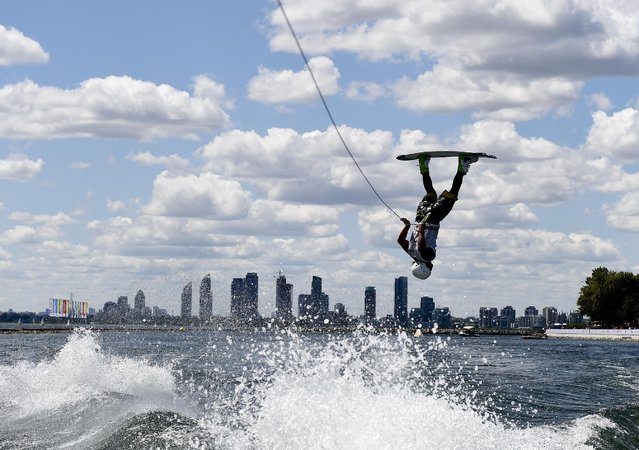 Venezuela's Juan Mendez competes in the men's wakeboard semifinal during the Pan Am Games in Toronto, Tuesday, July 21, 2015. (Photo by Nathan Denette/The Canadian Press via AP Photo)