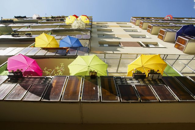 Colorful umbrellas on the balconies of the Ujpalota housing estate in Budapest, Hungary, Wednesday, July 22, 2015. (Photo by Zoltan Balogh/MTI via AP Photo)