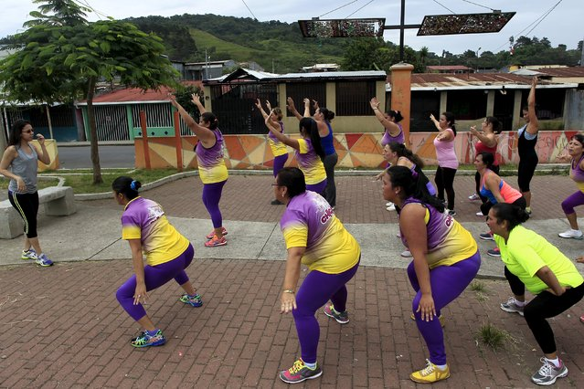Andrea Abarca, (L) leads an aerobics class in Los Guidos de Desamparados, Costa Rica July 23, 2015. More than 300 women participated in a physical health program organized by  Abarca, which aims to combat obesity and sedentary behavior in poor women living in a slum. The National Nutrition Survey shows that the Costa Rican population has 62.4 percent of adult men who are obese, while among women the percentage was 77.3, according to local media. (Photo by Juan Carlos Ulate/Reuters)