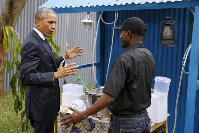 U.S. President Barack Obama (L) talks with a biofuel business owner at the Power Africa Innovation Fair at the United Nations compound in Nairobi, Kenya July 25, 2015. (Photo by Jonathan Ernst/Reuters)