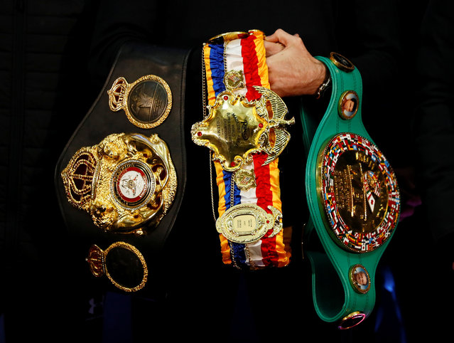 General view of Callum Smith holding the WBA Super World, WBC Diamond and Ring Magazine Super Middle Weight belts during the press conference at the Cunard Building, Liverpool, Britain on November 21, 2019.(Photo by Jason Cairnduff/Action Images via Reuters)