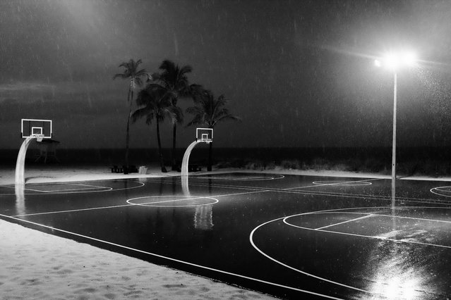 """""""Stormy playground"""". A stormy night on the beach playground. Photo location: Fort Lauderdale, FL, USA. (Photo and caption by Luca Boveri/National Geographic Photo Contest)"""