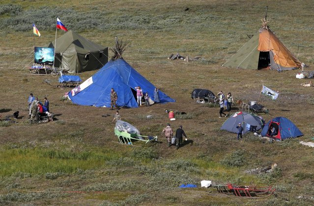 Tents are set up at a reindeer camping ground, some 200 km (124 miles) northeast of Naryan-Mar, the administrative centre of Nenets Autonomous Area, far northern Russia, August 2, 2015. (Photo by Sergei Karpukhin/Reuters)