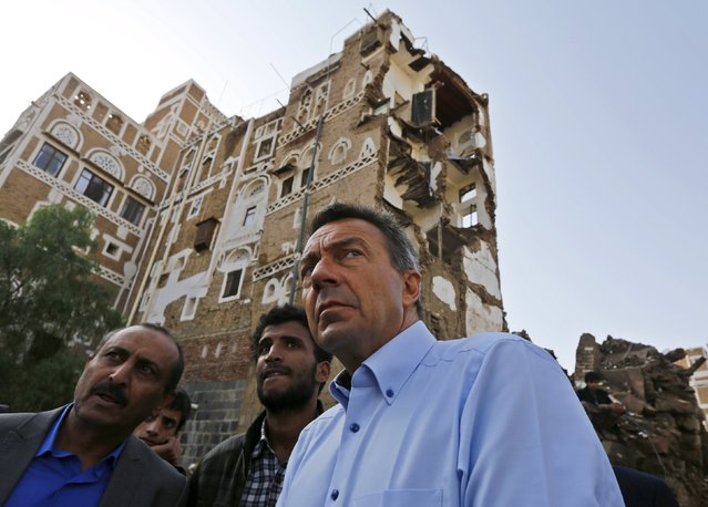 Peter Maurer (R), president of the International Committee of the Red Cross, looks as he tours a site which the Houthi-led authorities say was hit by a Saudi-led air strike at the old quarter of Yemen's capital Sanaa August 9, 2015. (Photo by Khaled Abdullah/Reuters)