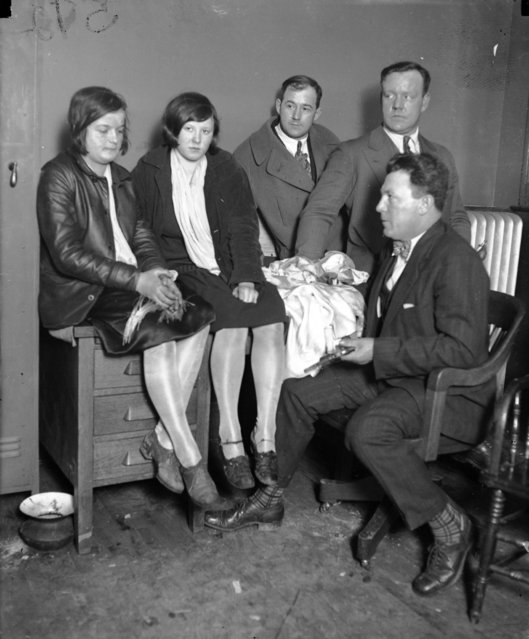 "Girl bandits Jean Buttick, 15, and Anna Varich, 16, were caught red-handed looting the bungalow of Louis Oehler at 6152 S. California Avenue on March 20, 1927.  The Chicago Tribune reported ""In the kitchen, as they seized her (Anna) she spilled rings, bracelets, beaded bags, and what not from every part of her clothes. When they shook her she literally dripped booty"". (Photo by Chicago Tribune Historical Photo)"