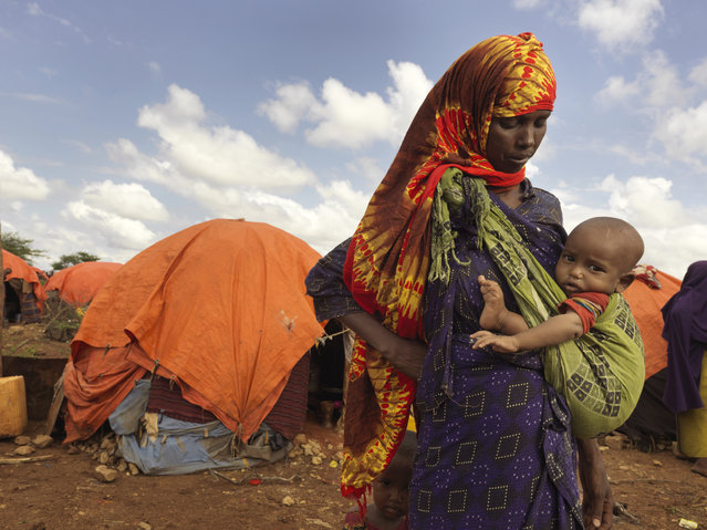 """Many Somalis in Baidoa say this drought is worse than the one in 2011, when famine was declared in parts of the country and more than 250,000 people died. A far lower death toll this time shows Somalia has been making progress against the odds – and the changing climate. """"I have two children and I live with my husband, we have been here in this camp for three months. We had to come here when our savings finished and our goats died. My family have always been farmers"""", says Kaltun Aliyow Mumin, 28, at Dusta camp in Baidoa. (Photo by Peter Caton/Mercy Corps)"""