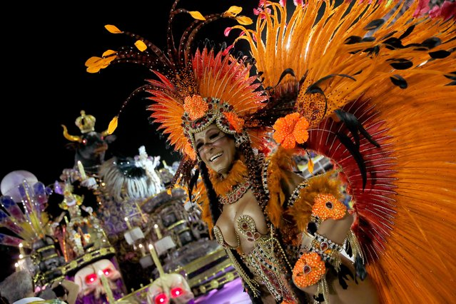 A reveller of Paraiso do Tuiuti samba school performs during the first night of the Carnival parade at the Sambadrome in Rio de Janeiro, Brazil on February 24, 2020. (Photo by Ricardo Moraes/Reuters)