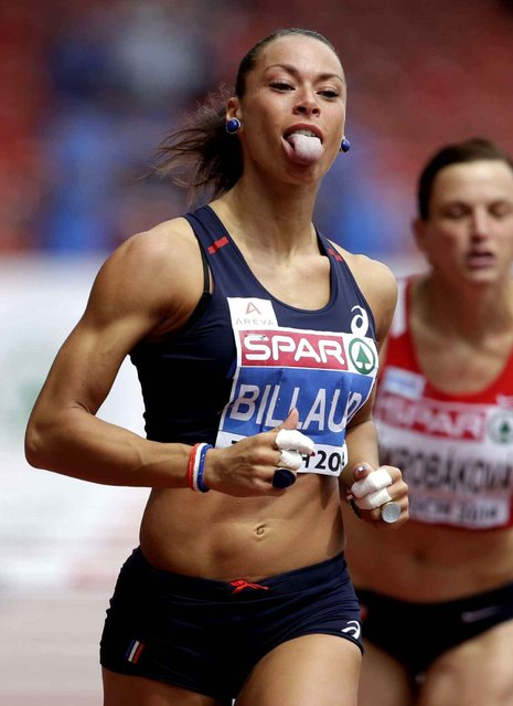 France's Cindy Billaud runs in her 100m hurdles heat during the European Athletics Championships in Zurich, Switzerland, Tuesday, August 12, 2014. (Photo by Petr David Josek/AP Photo)