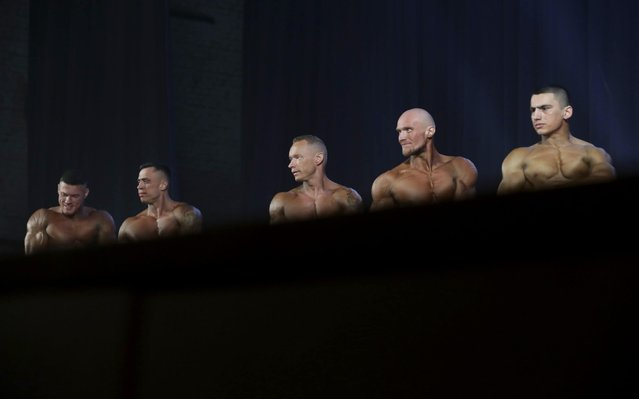 Participants in a local bodybuilding and fitness contest at Novosibirsk's Chkalov Palace of Culture in Novosibirsk, Russia on March 14, 2020. (Photo by Kirill Kukhmar/TASS)