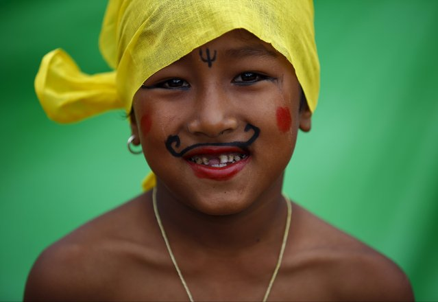 "A boy, dressed up as a holy man, takes part in a parade to mark the Gaijatra festival, also known as ""cow festival"", in Kathmandu, Nepal August 30, 2015. (Photo by Navesh Chitrakar/Reuters)"