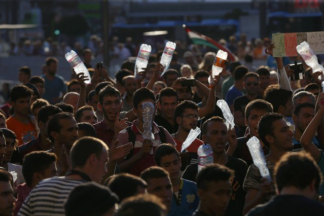 Migrants demonstrate outside the main Eastern Railway station in Budapest, Hungary, September 1, 2015. (Photo by Laszlo Balogh/Reuters)