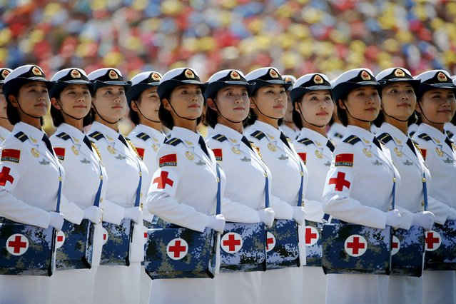 Military nurses look from atop a truck towards Chinese President and other leaders during the military parade marking the 70th anniversary of the end of World War Two, in Beijing, China, September 3, 2015. (Photo by Damir Sagolj/Reuters)