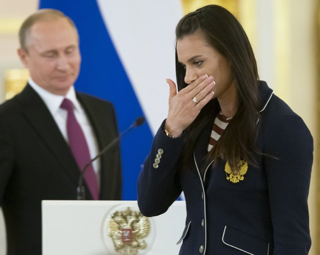 Russia's pole vaulter and Olympic champion Yelena Isinbayeva gestures after speaking at the Kremlin, in Moscow, Russia, Wednesday, July 27, 2016 during a reception for the Russia's Olympics team. At least 105 athletes from the 387-strong Russian Olympic team announced last week have been barred from the Rio Games in connection with the country's doping scandal. (Photo by Alexander Zemlianichenko/AP Photo)