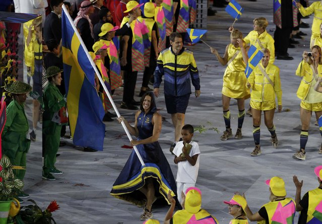 2016 Rio Olympics, Opening ceremony, Maracana, Rio de Janeiro, Brazil on August 5, 2016. Flagbearer Therese Alshammar (SWE) of Sweden leads her contingent during the opening ceremony. (Photo by Stoyan Nenov/Reuters)
