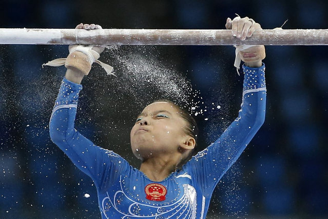 China's Shang Chunsong prepares to compete in the uneven bars event of the women's individual all-around final artistic gymnastics competition at the Namdong Gymnasium Club during the 17th Asian Games in Incheon September 23, 2014. (Photo by Kim Hong-Ji/Reuters)