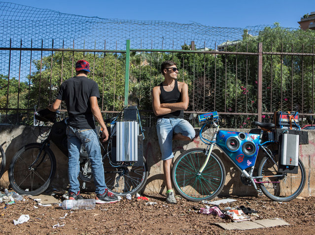 The police threaten to confiscate their sound systems. (Photo by Matteo de Mayda/Cosimo Bizzari/The Guardian)
