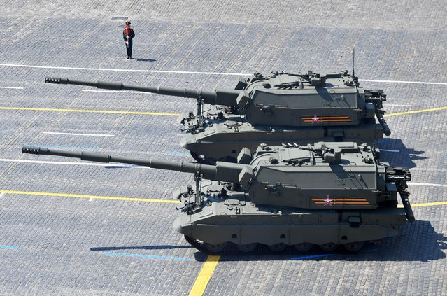 Russian Koalitsiya-SV self-propelled howitzers drive during the Victory Day Parade in Red Square in Moscow, Russia, June 24, 2020. (Photo by Mikhail Voskresensliy/Host Photo Agency via Reuters)