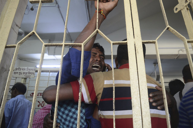 An unidentified relative of a stampede victim cries at the Chittagong medical hospital, in Chittagong, Bangladesh, Monday, December 18, 2017. Police in Bangladesh say at least 10 people have been killed and another 40 injured in a stampede at a jam-packed religious ritual for a popular mayor who died last week. (Photo by AP Photo/Stringer)