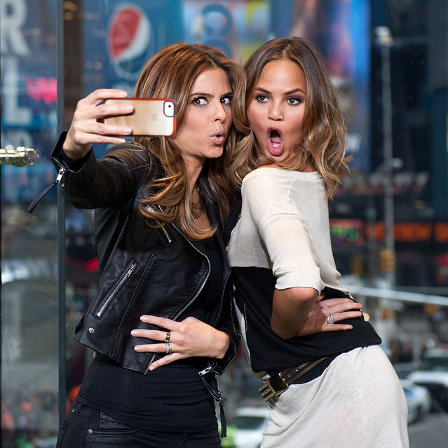 "(L-R) Maria Menounos (L) and Chrissie Teigen visit ""Extra"" in Times Square on January 31, 2014 in New York City. (Photo by D. Dipasupil/Getty Images for Extra)"