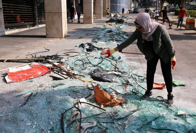 A woman stands near broken glass following Tuesday's blast in Beirut's port area, in Beirut, Lebanon on August 7, 2020. (Photo by Aziz Taher/Reuters)