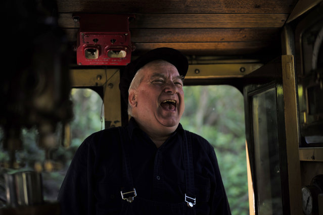 Puffing Billy steam engine driver Steve Holmes, 61, laughs as he jokes with fireman Barry Rogers on the footplate of a locomotive at Lakeside Station near Melbourne, October 20, 2014. (Photo by Jason Reed/Reuters)